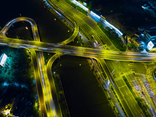 Long Exposure Drone Photo of a Bridge System over Saigon River connecting three Districts in Ho Chi Minh City, Vietnam