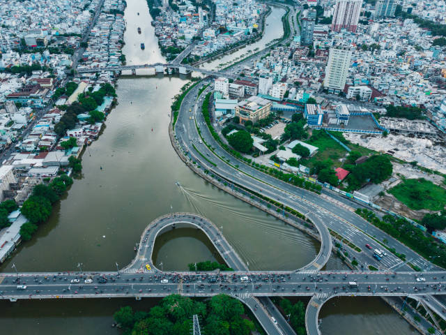 Bird View Drone Photo of a Traffic Jam on a Multi Level Bridge over Saigon River with many Motorbikes and Cars in Ho Chi Minh City, Vietnam