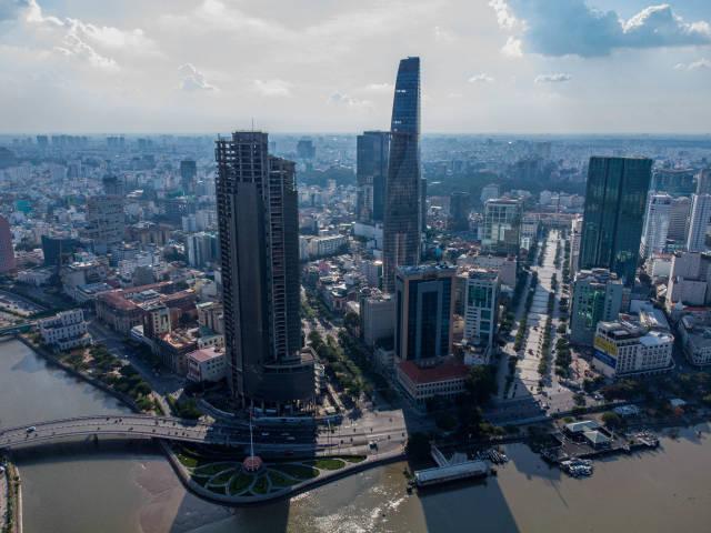 Aerial Drone Photo of Saigon Skyline with Nguyen Hue Walking Street, Thu Ngu Flagpole, Bitexco Financial Tower and Saigon One in Ho Chi Minh City, Vietnam
