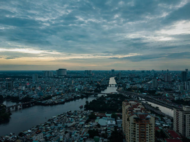 Aerial Sunset Drone Photo of Bridges over Saigon River connecting District 1, District 4 and District 8 in Ho Chi Minh City, Vietnam