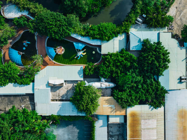 Top View Drone Photo of the abandoned KizCiti Water Park with Playground Airplane and Swimming Pools within Khanh Hoi Park in Ho Chi Minh City, Vietnam