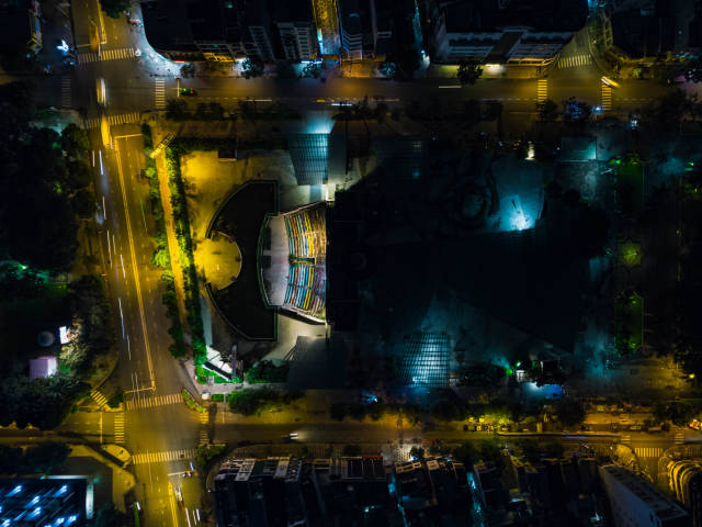Night Drone Photo of Performance Art Theatre and Pham Ngu Lao Street at 23/9 Park in Ho Chi Minh City, Vietnam
