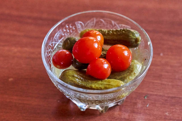 A bowl of delicious pickled cucumbers and tomatoes