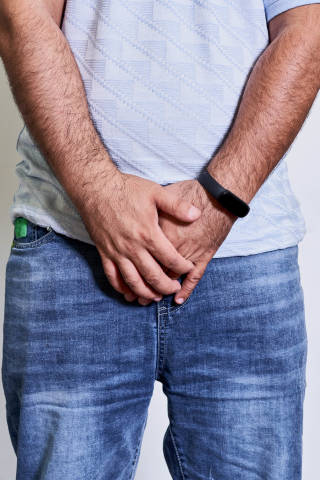 A man holds his groin area. Concept of prostatitis illness
