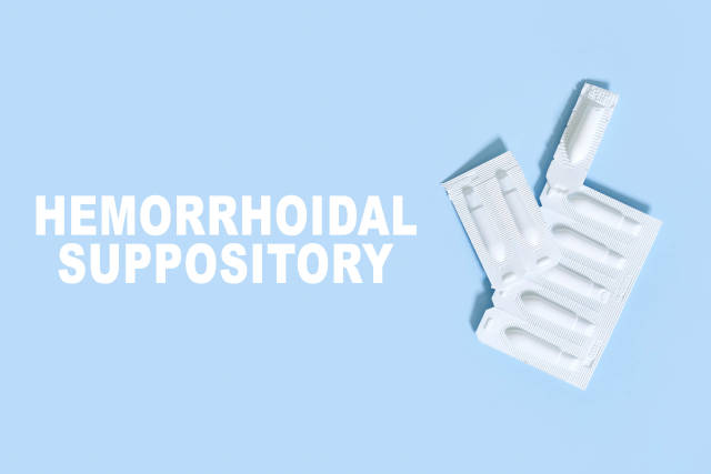 Hemorrhoidal suppositories on bright blue background