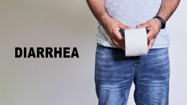 Diarrhea concept - Man holds a toilet paper