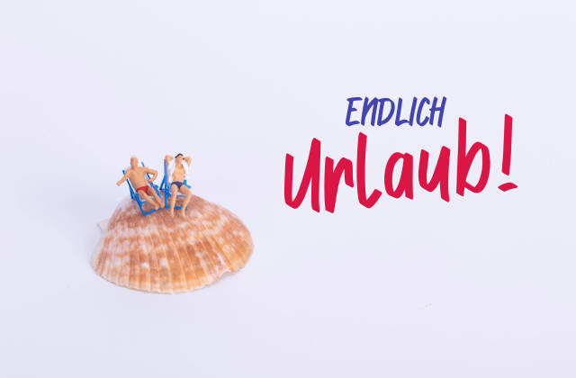 Two man sitting in deck chairs on sea shell with Endlich Urblaub text
