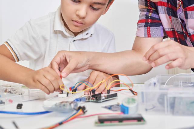 Young technicians building a robot
