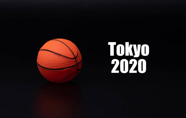Basketball ball with Tokyo 2020 text on black background