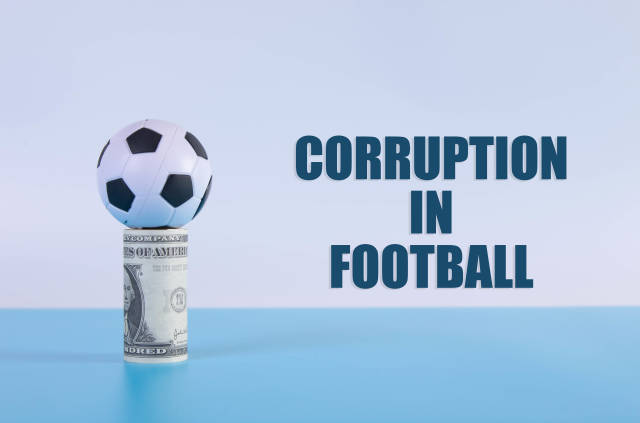 Soccer ball on a money roll with Corruption in Football text