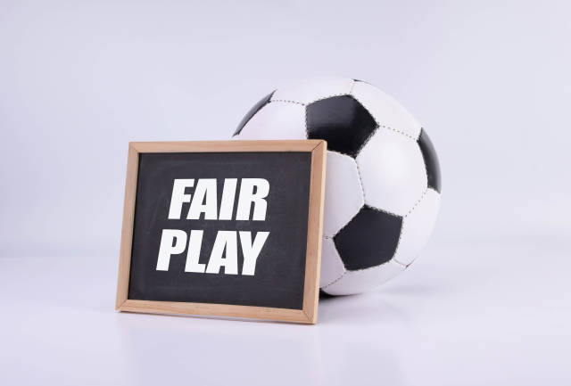 Soccer ball and chalkboard with Fair play text
