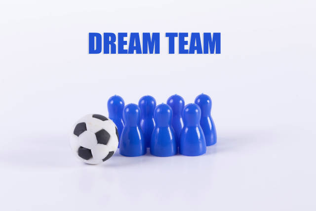 Blue board game pawn figures with soccer ball and Dream team text