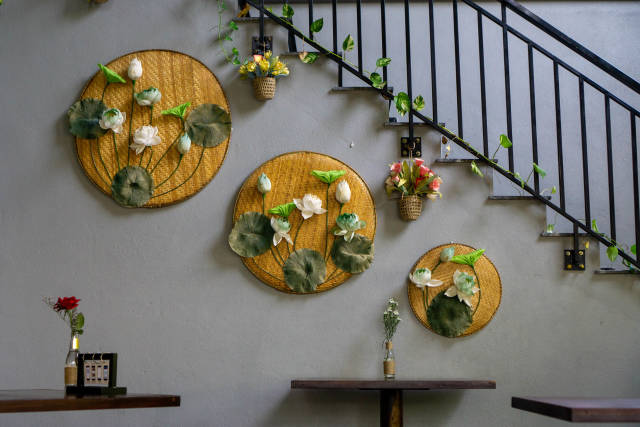 Wall Decorations with Flowers on Bamboo Boards and Basket Plant Pots inside a modern Vietnamese Restaurant