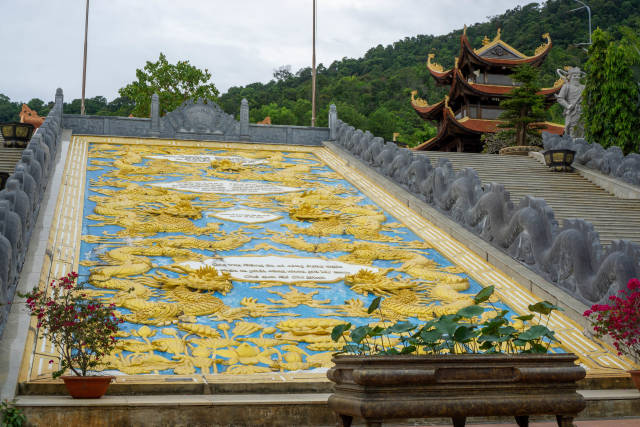 Large Golden Dragon Stone Ornament between Stairs at Ho Quoc Temple on Phu Quoc Island in Vietnam