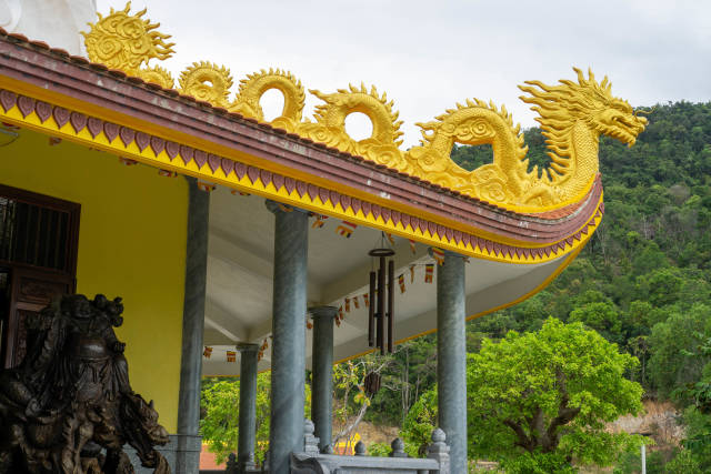Golden Dragon Ornament on top of a Buddhist Temple Building at Ho Quoc Temple Complex on Phu Quoc Island, Vietnam