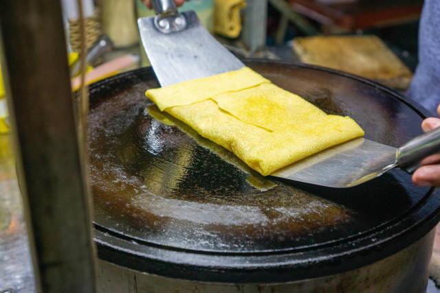 Close Up Food Photo of Sweet Banana Roti at a Street Food Cart at the Night Market in Hoi An, Vietnam