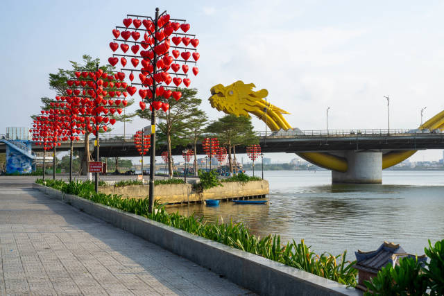 Riverside Park with Heart-Shaped Street Lights next to the famous Dragon Bridge over the Han River in Da Nang, Vietnam