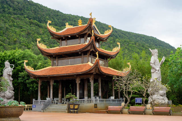 Buddhist Temple Building with Large Warrior Statues on a Mountain at Truc Lam Ho Quco Zen Monastery on Phu Quoc Island, Vietnam