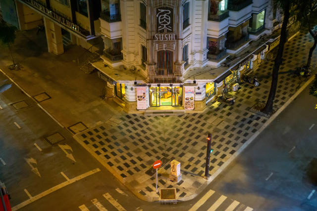 Top View Photo of Sushi Tei Restaurant with Empty Street and Sidewalk in the City Center in District 1 in Ho Chi Minh City, Vietnam