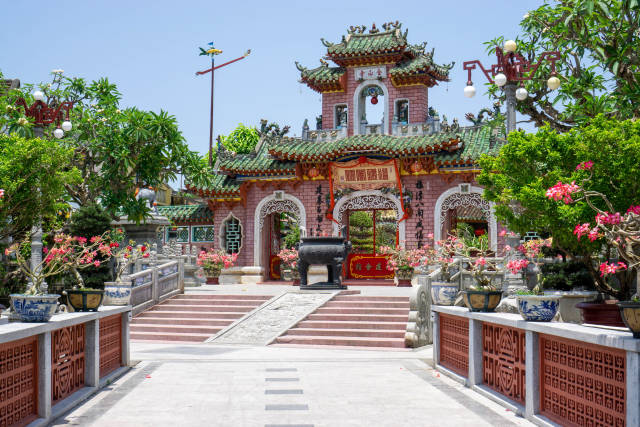 Entrance Stone Gate of the Assembly Hall of Fujian Chinese and Phuc Kien Pagoda with many Ornaments, Lanterns and Statues in the Old Town of Hoi An, Vietnam