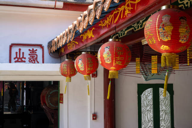 Red Chinese Lantern with Golden Letters and Incense Cones with Wishes hanging inside Phuc Kien Pagodda at the Assembly Hall of Fujian Chinese in Hoi An, Vietnam