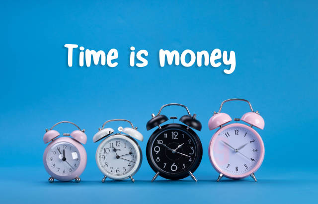 Alarm clocks with Time is Money text on blue background