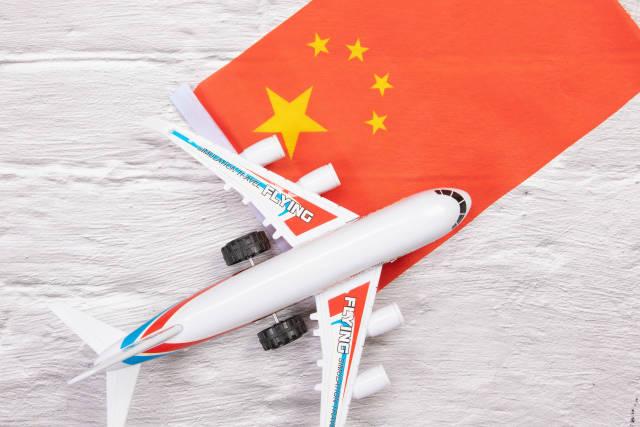 Miniature airplane over flag of China