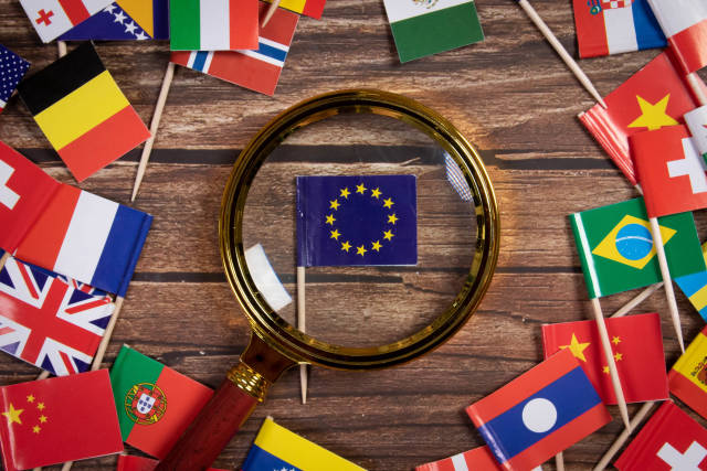 Magnifying glass on the flag of European Union