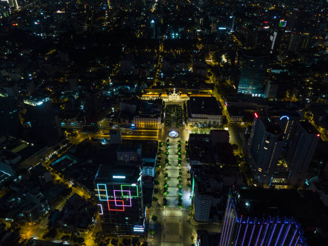 Bird View Drone Photo of the Lotus Flower Water Fountain in front of the Ho Chi Minh Statue and the Peoples Committee Building on Nguyen Hue Walking Street in Saigon, Vietnam