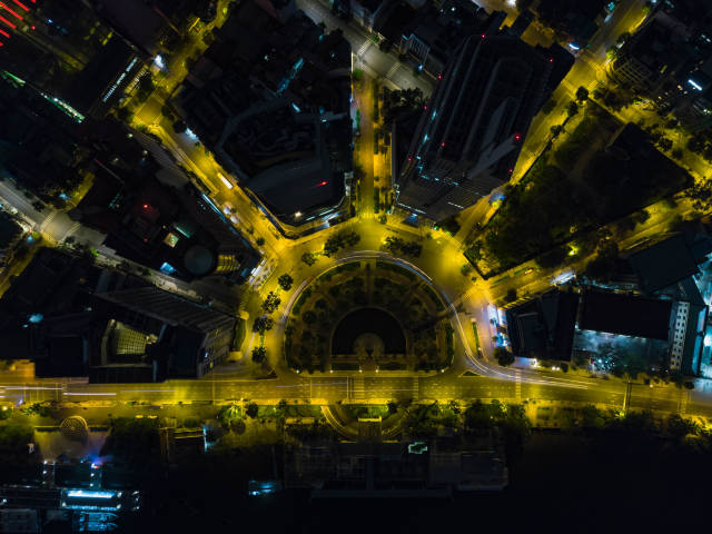 Long Exposure Drone Photo of the Roundabout around Tran Hung Dao Statue with Hilton Hotel and Renaissance Riverside Hotel in Ho Chi Minh City, Vietnam