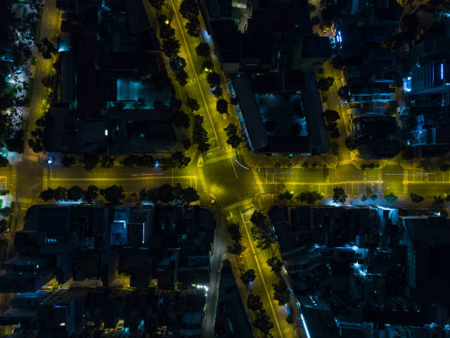 Top View Drone Photo of the Intersection of Tran Hung Dao and Nguyen Thai Hoc Street with Long Exposure Light Streaks in Ho Chi Minh City, Vietnam