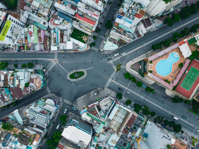 Top View Drone Photo of light Traffic in Phu Dong Roundabout with 6 exits at New World Saigon in Ho chi Minh City, Vietnam