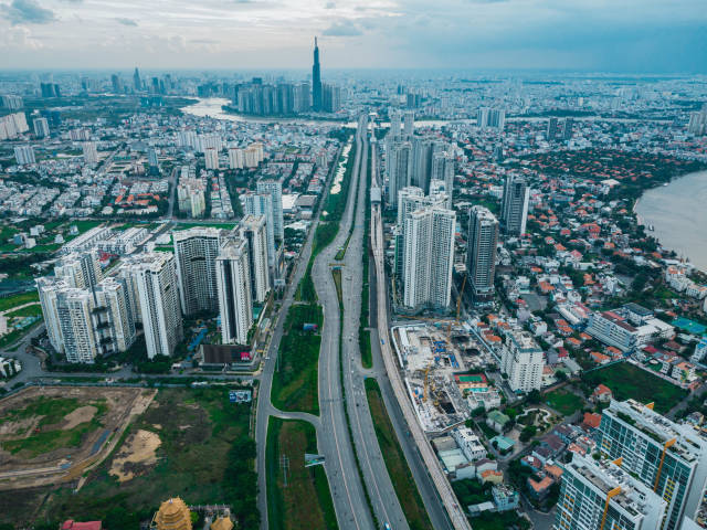 Aerial Drone Photo of Ho Chi Minh City, Vietnam with many Apartment Buildings, Construction Sites, Skyscrapers and the Saigon Metro Line