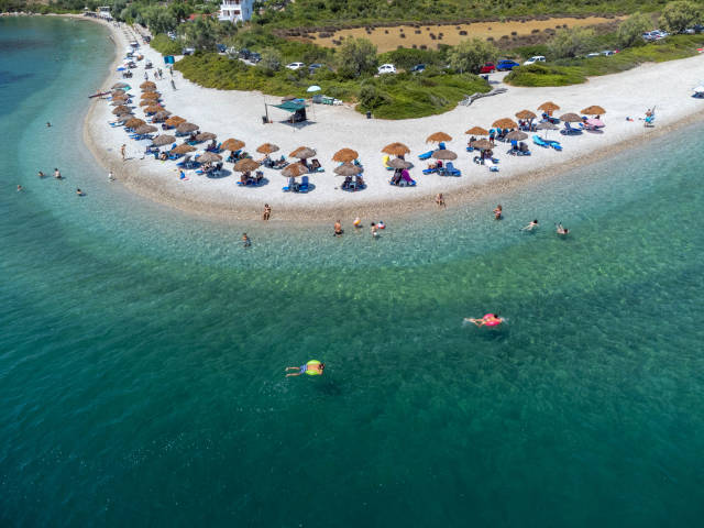 Holidaymakers enjoying the transparent waters of Paralia Agios Dimitrios on Alonnisos in summer 2021