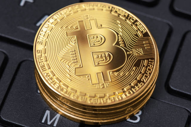Golden bitcoins on the keyboard