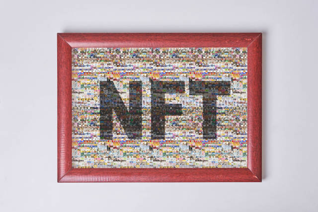 A picture frame with a collage photos NFT art on white wall