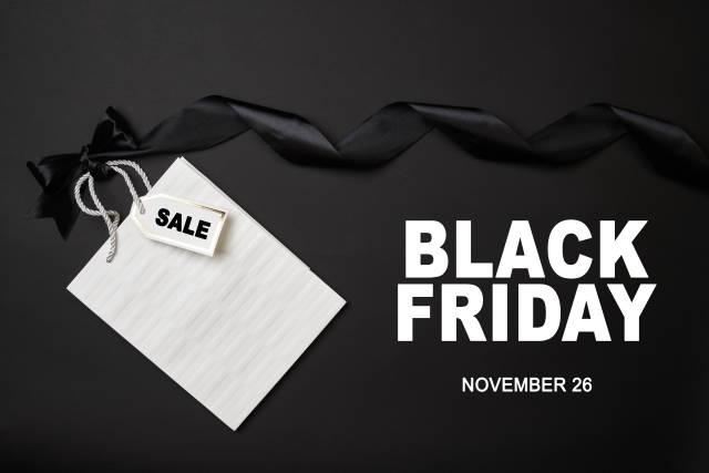 Black Friday 2021 - 26 November with white shopping bag and ribbon