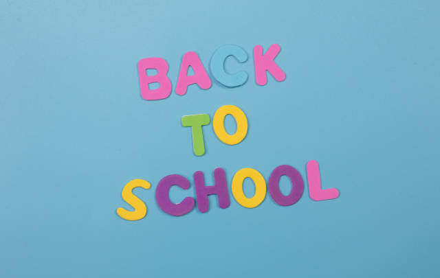 Colorful Back to School text on blue background