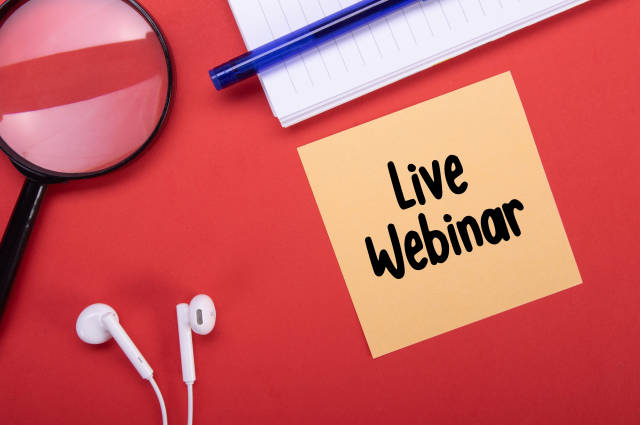Magnifier, headphones and note with Live Webinar text on red background
