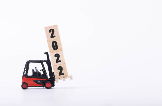 Red forklift with wooden block and 2022 text