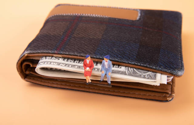 Older couple sitting on a wallet