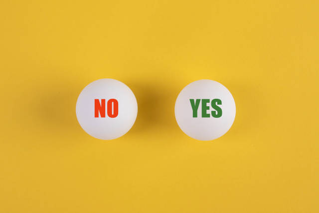 Table tennis balls with Yes and No text