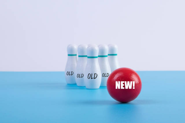 Bowling pins with Old text and bowling ball with New text