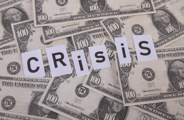 Dollar banknotes and Crisis text
