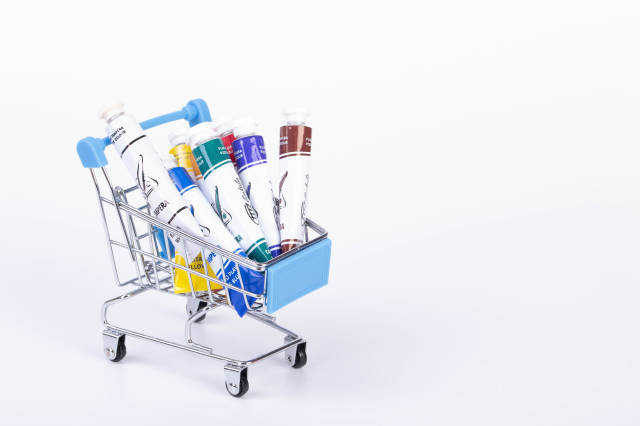 Shopping cart full of painting colors