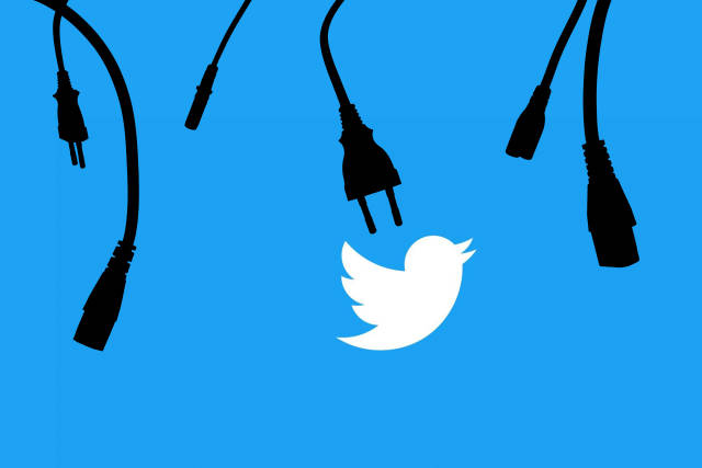 Unplugged data cables over Twitter logo. Symbol of Twitter crash