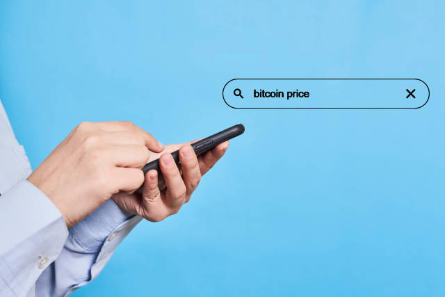 A person searching information about bitcoin price