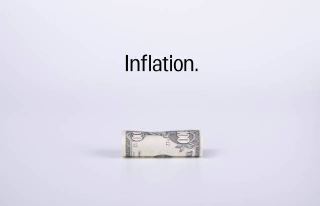 100 dollar banknote with Inflation text on white background