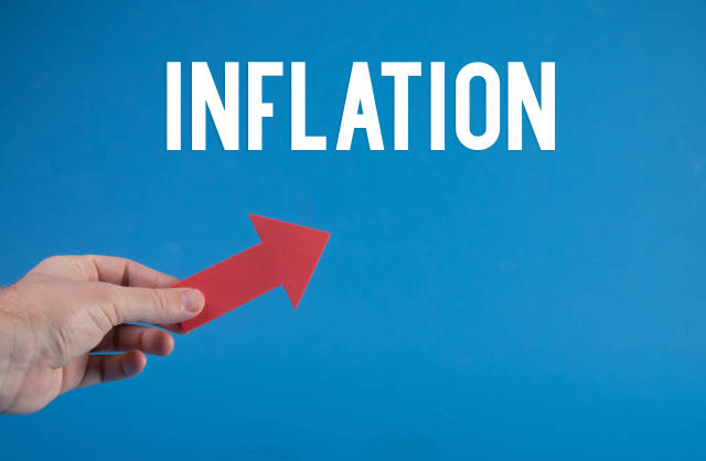 Hand holding red arrow and Inflation text on blue background